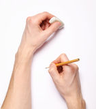 Human hands with pencil and eraser Stock Photos