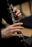 Human hands playing a clarinet Royalty Free Stock Photography