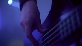 Human hands playing on electric guitar. Rock and roll musical show. Human hands playing on electric guitar. Close up of rock musician playing guitar on stage stock video footage