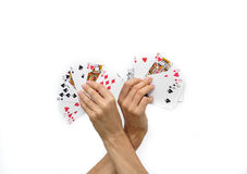 Human hands with poker cards isolated on white background Stock Image