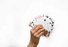 Human hands with poker cards isolated on white background Royalty Free Stock Image