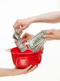 Human hands putting  money in the hard hat Stock Photo