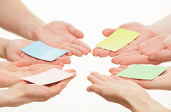Human hands reaching out colorful paper cards Royalty Free Stock Photography