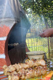 Human hands roasting appetizing barbecue on fire Royalty Free Stock Photography
