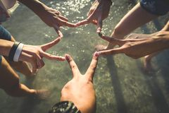Human hands at the sea with vintage style. Royalty Free Stock Image