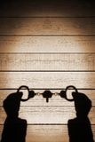 Human Hands Shadow with Handcuffs on Natural Wooden Backround, X Stock Photography