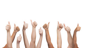 Human hands showing thumbs up Stock Images