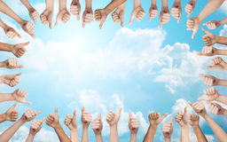 Human hands showing thumbs up in circle Stock Image