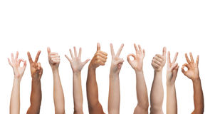 Human hands showing thumbs up, ok and peace signs. Gesture and body parts concept - human hands showing thumbs up, ok and peace signs Royalty Free Stock Photography
