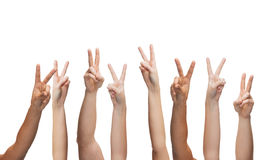 Human hands showing v-sign Stock Photos