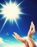 Human Hands, sun and blue sky Stock Photo