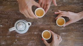 Human Hands Taking Tea Cups from Wooden Rustic Table and Drinking Traditional Chinese Green Tea Ceremony view from Above stock video