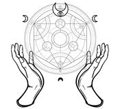 Human hands touch an alchemical circle. Mystical symbols, sacred geometry. Stock Photos