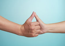 Human hands touching with thumb Royalty Free Stock Images