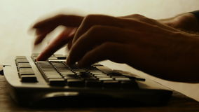 A human hands typing on a keyboard stock video footage