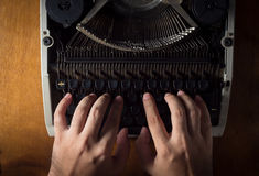 Human hands typing with typewriter. Stock Photos