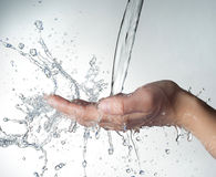 Human hands with water splashing on them Stock Photography