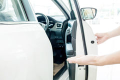 Human hands welcoming people to go chauffeur seat.  Royalty Free Stock Photography