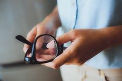 Human hands woman holding eyeglasses Stock Photography
