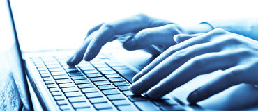 Human hands working on laptop Stock Images