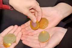 Human handsgiving and receiving golden coins Royalty Free Stock Photos