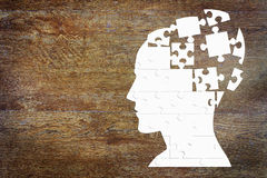 Human head as a set of puzzles on the woods. Human head as a set of puzzles on the wooden background Royalty Free Stock Photos