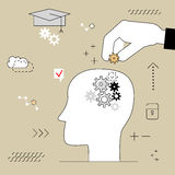 Human head with gears . Thinking education. Hand puts the item  Stock Photos