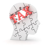 Human head made of puzzle pieces with tax text Royalty Free Stock Photo
