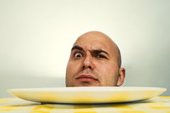 Human head on plate Royalty Free Stock Image