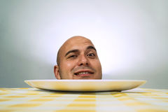 Human head on plate Royalty Free Stock Photography