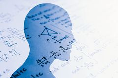 Human head shape with math quiz paper for problem solving education concept stock images