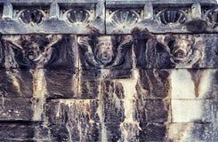 Human heads decorates a wall in Sibenik, Croatia stock photos