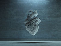 Human Heart. Suspended in Industrial Space Stock Photo
