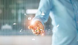 Human holding drugs tablets and pills in hand with medical icon. Medicine. Human holding drugs tablets and pills in hand with icon medical network connection on royalty free stock photography