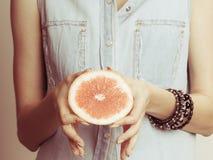 Human holding grapefruit. Healthy diet food. Stock Photo