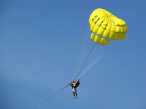 Human holding yellow parachute Royalty Free Stock Photos