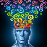 Human Imagination. And creative man as the intelligent brain with a front facing human head that has rainbow spectrum colored gears and cogs expressing itself Stock Image