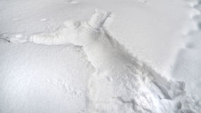 : Human imprint on the snow. Rod on the ice waiting for the fish bite Stock Image