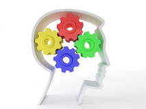 Human intelligence. And brain function represented by gears in the shape of a head representing the symbol of mental health and neurological functioning in Stock Photography