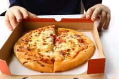 Human kid hand with pizza box close up Stock Photos
