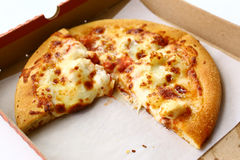 Human kid hand with pizza box close up Stock Image