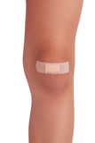 Human knee, sealed plaster Royalty Free Stock Image