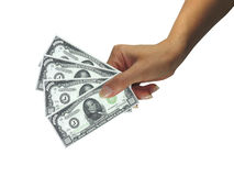 Human lady hand giving cash dollars isolated over Royalty Free Stock Images