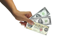 Human lady hand giving cash rare dollars currency Royalty Free Stock Photography
