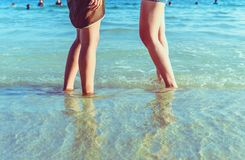 Human leg on the beach with vintage style. Royalty Free Stock Images