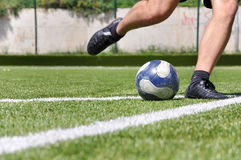 Human leg shooting soccer ball Stock Photo
