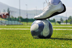 Human leg and soccer ball Stock Photography