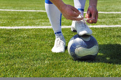 Human leg and soccer ball Royalty Free Stock Photo