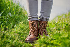 Human legs in boots on summer meadow Stock Photography