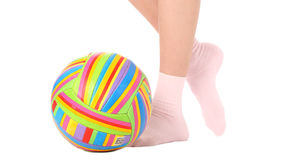 Human legs with a multicolored ball Royalty Free Stock Image